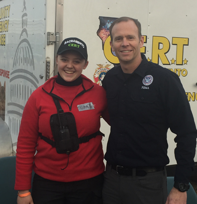 Former FEMA Administrator Brock Long takes a photo with Grace Harris in Butte County, California.